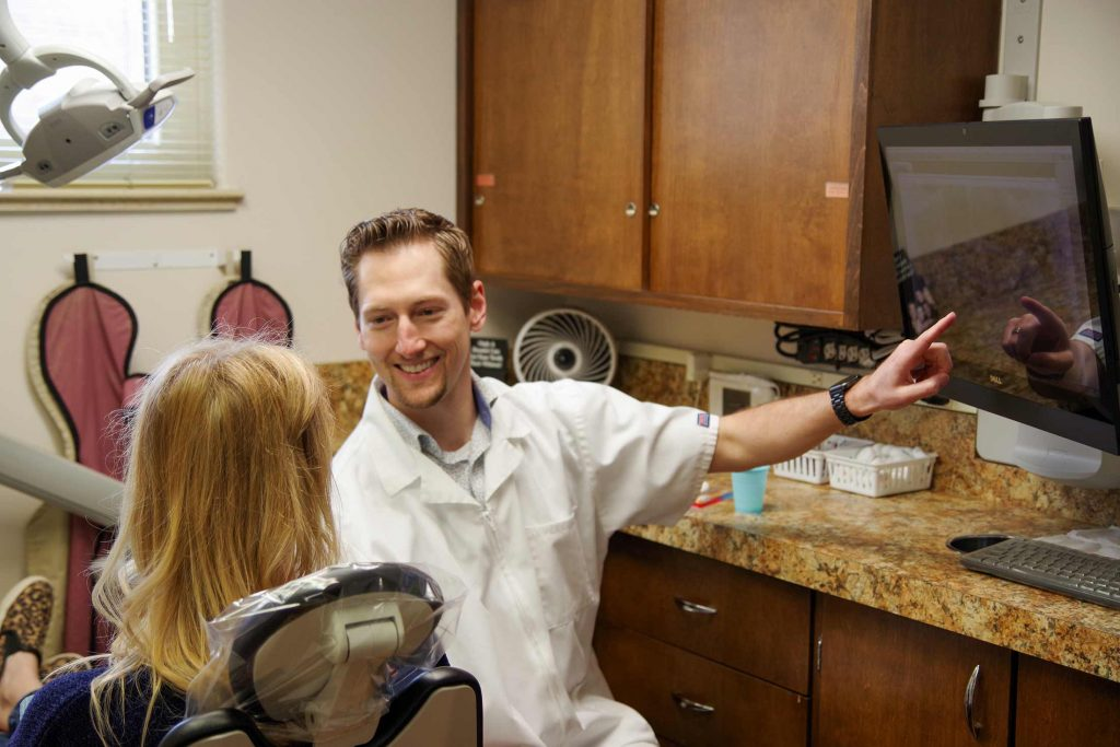 Dr. Dustin Ebner consults with a patient at Ebner Family Dentistry