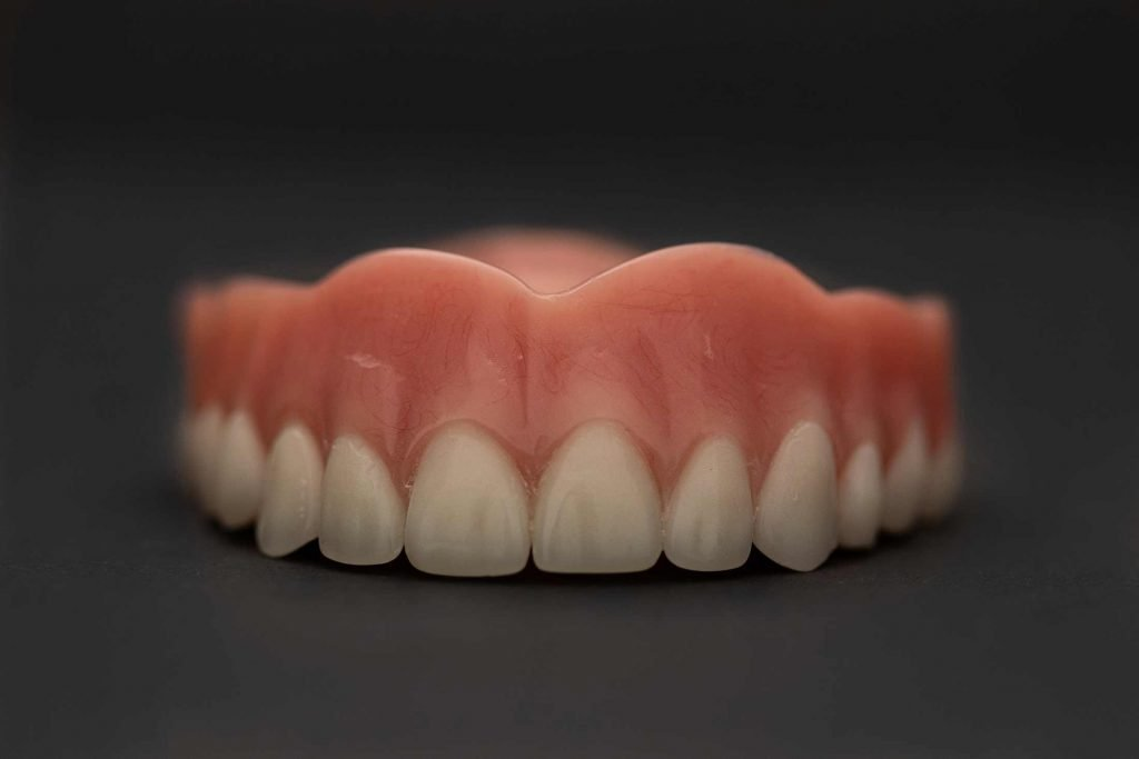 a close up of a set of upper teeth dentures
